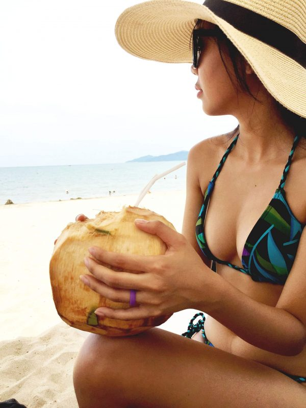 a women in beach with silicone ring in hand