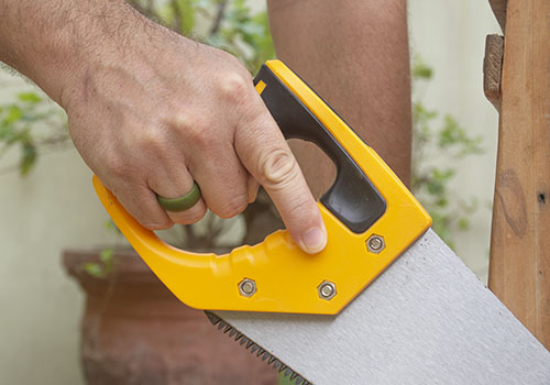 Man sawing while wearing Swagmat silicone rings for men